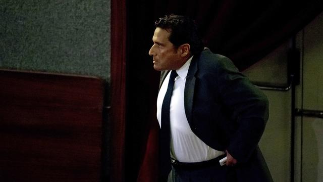 Captain Francesco Schettino walks in the court room of the converted Teatro Moderno theater for his trial