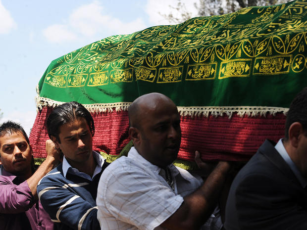Pallbearers carry the coffin of Kenyan journalist Ruhila Adatia-Sood during a funeral ceremony in Nairobi, Kenya, Sept. 26, 2013.