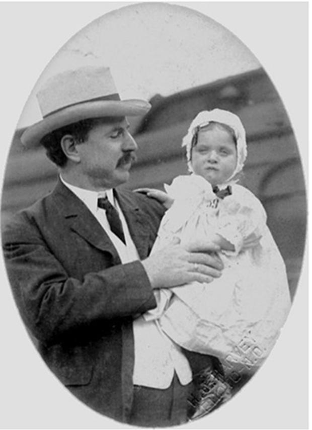 019_Rare_photo_of_a_child_received_off_an_orphan_train_in_Louisiana_wearing_ribbon_and_tag_number.jpg