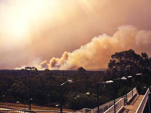Smoke rises from a fire near Springwood, west of Sydney, Australia