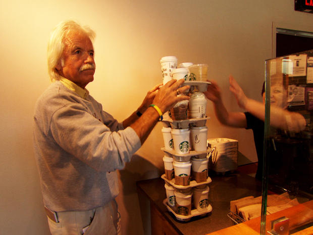 Dan buys a towering stack of coffees.