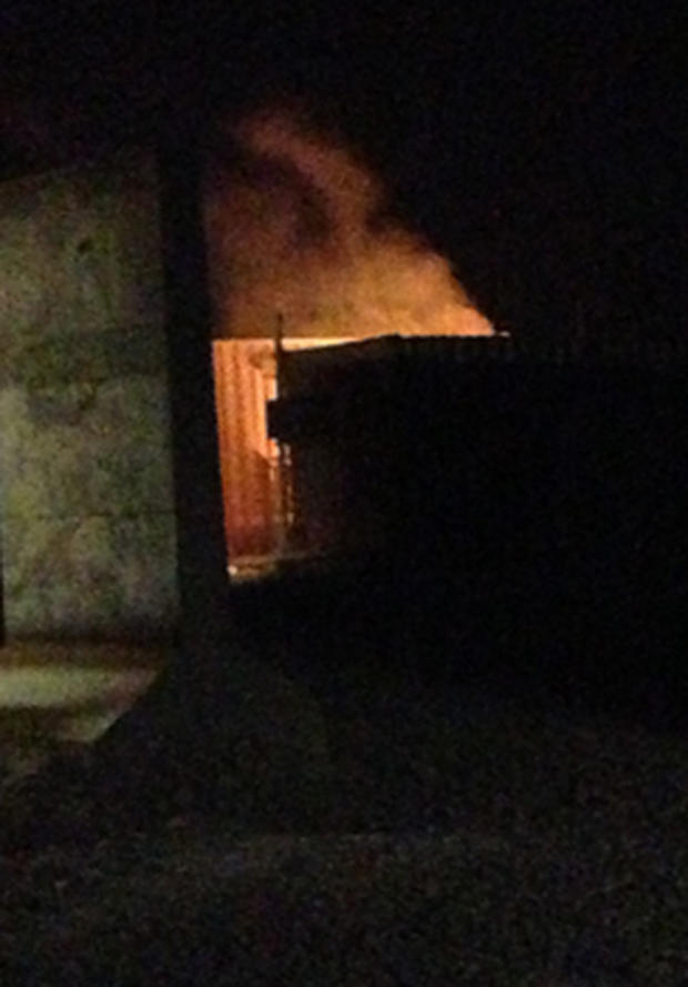 Flames come from a building after a rocket attack on Forward Operating Base Shank