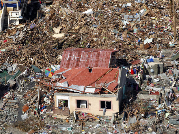 An aerial view shows signs for help and food amid the destruction left from Typhoon Haiyan in the coastal town of Tanawan, Philippines, Nov. 13, 2013.