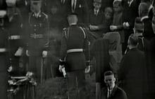 JFK widow lights eternal flame at gravesite