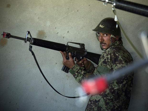 Afghan army soldiers get house-to-house search instructions at a training facility in the outskirts of Kabul