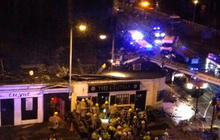 Police helicopter crashes into Glascow pub, dozens hurt