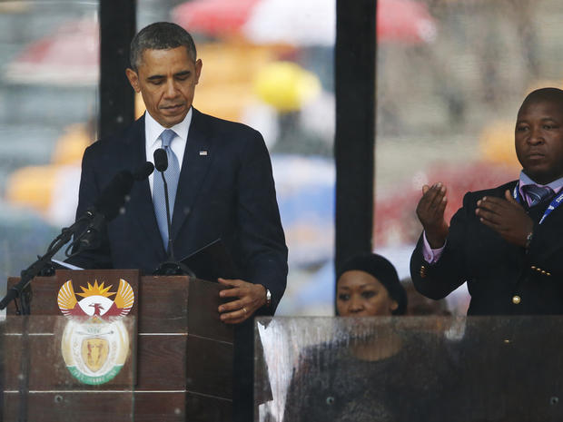 President Obama looks down as he stands next to the sign-language interpreter as he makes his speech at the memorial service for former South African President Nelson Mandela at FNB Stadium in Soweto near Johannesburg Dec. 10, 2013.