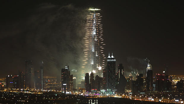 Fireworks explode from the Burj Khalifa, the world's tallest building, at midnight to celebrate the New Year, Jan. 1, 2014, in Dubai, United Arab Emirates