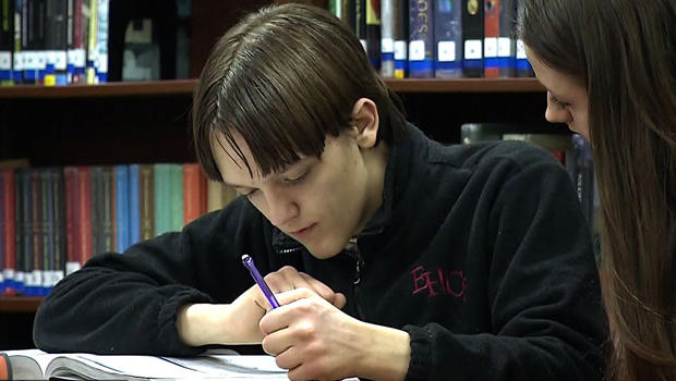 """Austin Miller, who has Asperger's syndrome, is seen during a story broadcast on the """"CBS Evening News"""" Jan. 14, 2014."""