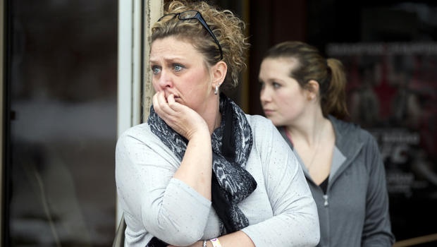 Restaurant general manager Heather Saffield and employee Chelsea Borschart, right, look outside their restaurant at The Mall in Columbia Jan. 25, 2014, in Columbia, Md.