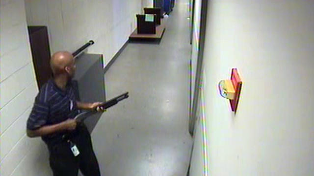 Aaron Alexis moves through the hallways of Building #197 at the Washington Navy Yard in Washington carrying a Remington 870 shotgun Sept. 16, 2013, in this handout framegrab provided by the FBI.