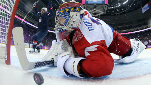 USA forward Phil Kessel reacts as Russia goaltender Sergei Bobrovski can't stop a goal by USA defenseman Cam Fowler during the second period of a men's ice hockey game at the 2014 Winter Olympics Feb. 15, 2014, in Sochi, Russia.