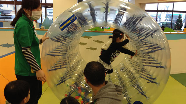 """Parents look on as their children play at the indoor """"Pep Kids Koriyama"""" play space"""