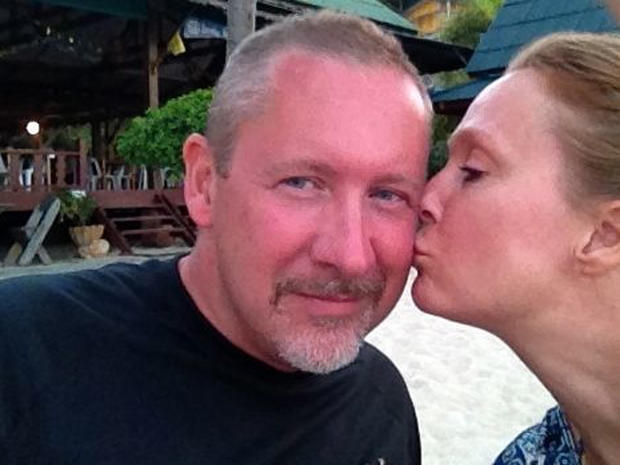 A photo provided by Sarah Bajc shows her kissing long-time boyfriend Phil Wood