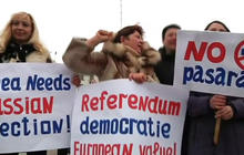 Russian forces tighten grip on Crimea as referendum looms