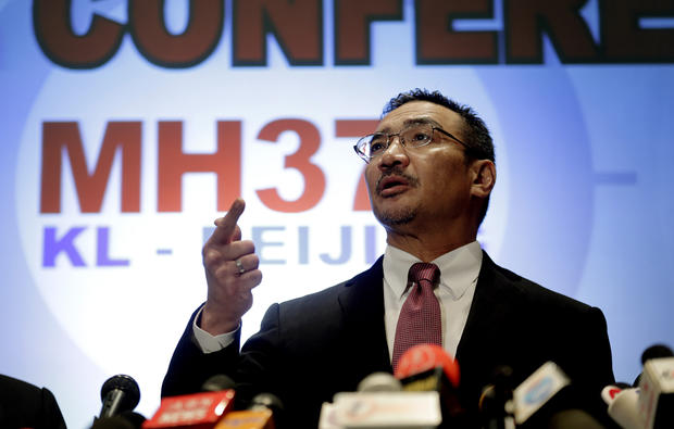 Malaysia's Minister of Transport Hishamuddin Hussein takes questions from the media during a press conference about the missing Malaysia Airlines jetliner MH370