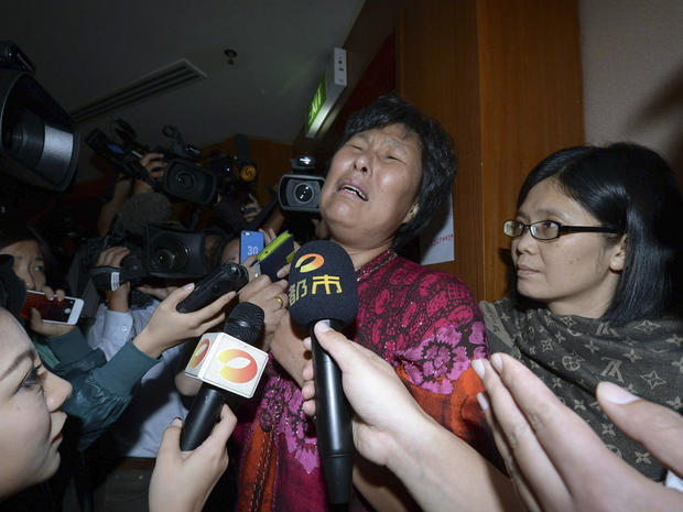 A Chinese relative of passengers aboard Malaysia Airlines Flight 370 cries as she speaks to journalists at a hotel in Sepang, Malaysia, March 19, 2014.