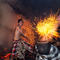Balinese men play with burning coconut husks to celebrate Nyepi Day