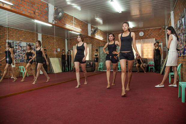 Cambodian models train for the camera
