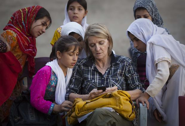 AP Special Regional Correspondent for Afghanistan and Pakistan Kathy Gannon sits with girls at a school in Kandahar