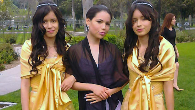 Twin sisters Marisol Serrato, 17, left, and Marisa Serrato, right, with their sister-in-law, Ivette Serrato, are seen during a wedding in Riverside, Calif., in this 2013 photo provided by Miguel Serrato.