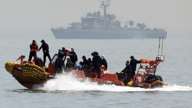 South Korean rescue workers operate around the area where capsized passenger ship Sewol sank