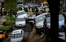 Street collapse in Baltimore sends parked cars tumbling