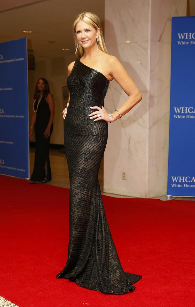 Television personality Nancy O'Dell arrives on the red carpet at the annual White House Correspondents' Association dinner in Washington May 3, 2014.