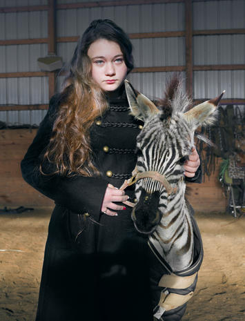 Mother photographs daughter with animals for 12 years