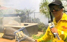 California reporter puts out wildfire flames while on air