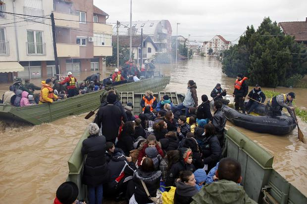 Serbian army soldiers evacuate people in amphibious vehicles in the flooded town of Obrenovac