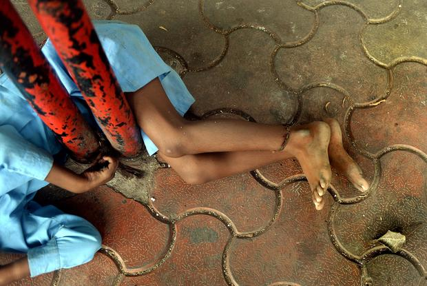 Disabled Indian boy tethered to bus stop as grandmother works