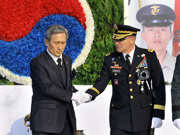 South Korean Defence Minister Kim Kwan-Jin (L) shakes hand with General Curtis Scaparrotti, commander of U.S. Forces Korea