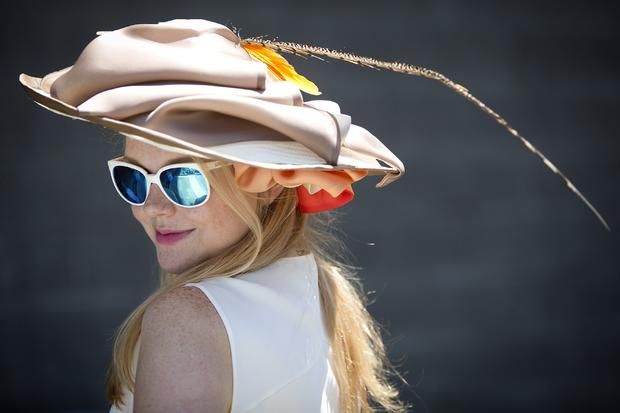 Mary Frances Dale poses for a portrait with her colorful hat before the 146th running of the 2014 Belmont Stakes in Elmont, New York, June 7, 2014.