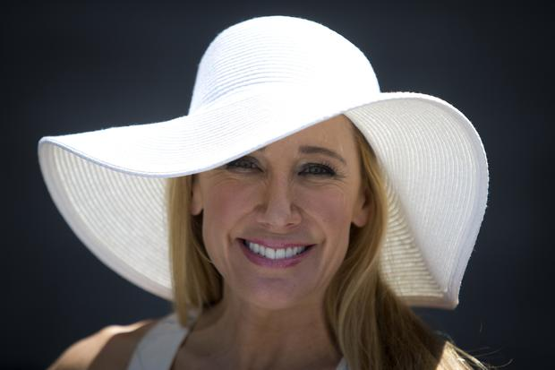 Diana Val poses for a portrait with her hat before the 146th running of the 2014 Belmont Stakes in Elmont, New York, June 7, 2014.