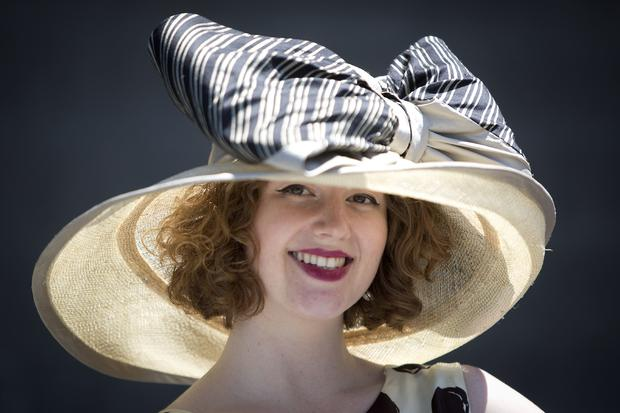 Kendall Owings poses for a portrait with her hat before the 146th running of the 2014 Belmont Stakes in Elmont, New York, June 7, 2014.