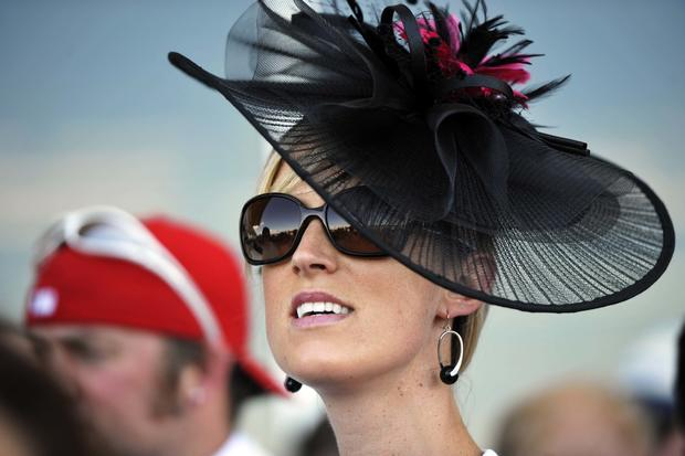 Sally Ness of Ithaca, New York, looks on before the 2014 Belmont Stakes at Belmont Park in Elmont, New York, June 7, 2014.