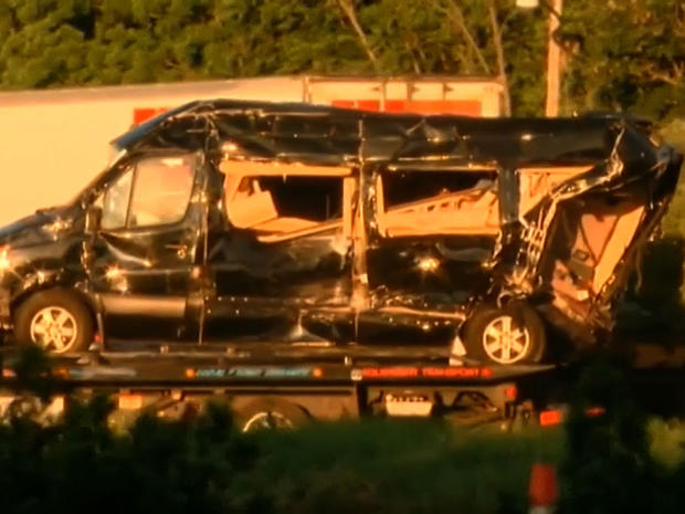 The wreckage of a limousine bus transporting actor Tracy Morgan is removed from the scene of a deadly accident on the New Jersey Turnpike June 7, 2014.