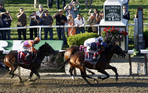 Tonalist, with jockey Joel Rosario in the irons (11), edges Commissioner, with jockey Javier Castellano in the irons (8), as Medal Count, with jockey Robby Albarado in the irons, follows at the 146th running of the Belmont Stakes at Belmont Park in Elmont