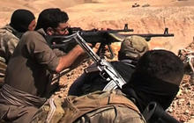 Militants fight Iraqi forces for key refinery