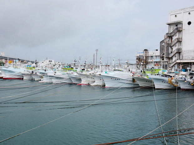 Fishing boats are moored at Tomari port in Naha, on Japan's southern island of Okinawa, as Typhoon Neoguri approaches the region
