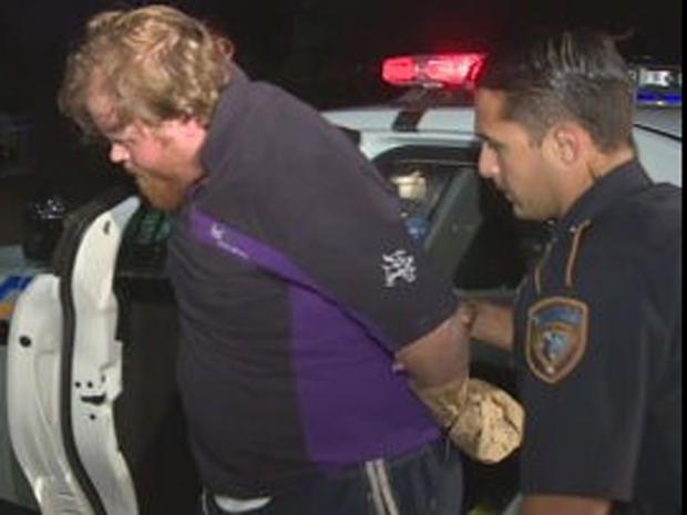 Ronald Lee Haskell, identified as the suspect in the shooting deaths of several people in the Houston suburb of Spring, is taken into custody July 9, 2014.