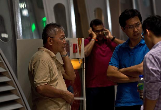 Malaysia Airlines Flight 17 passengers' relatives wait for news