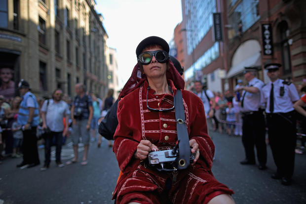 Little Giant Girl marches through Liverpool