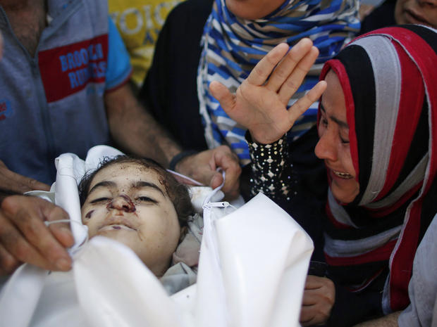 Relatives of Palestinian girl Layan al-Silk, whom medics said was killed with other family members by Israeli shelling at a market in Gaza City's Shijaiyah district, mourn during her funeral