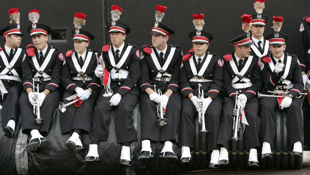 Ohio State band members rally against decision to fire
