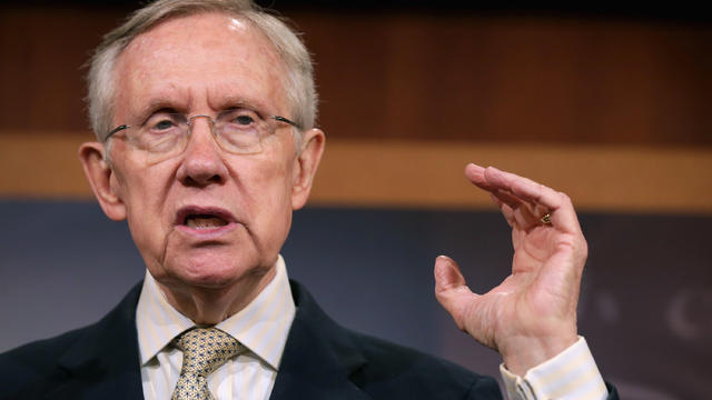 Senate Majority Leader Harry Reid, D-Nev., answers reporters' questions during a news conference at the U.S. Capitol July 10, 2014, in Washington.