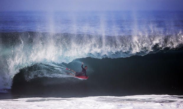 Surfers delight in Hurricane Marie's big waves