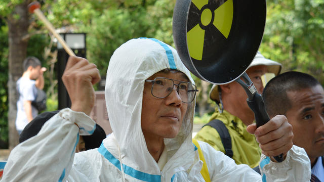 An anti-nuclear demonstrator protests in front of the Nuclear Regulatory Authority (NRA) in Tokyo