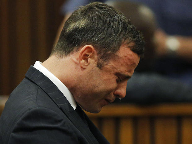 Olympic and Paralympic track star Oscar Pistorius reacts as he listens to Judge Thokozile Masipa's judgement at the North Gauteng High Court in Pretoria